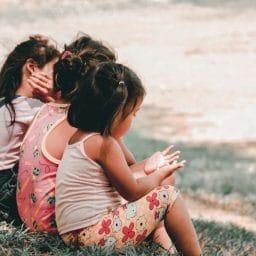 Children sitting on grass