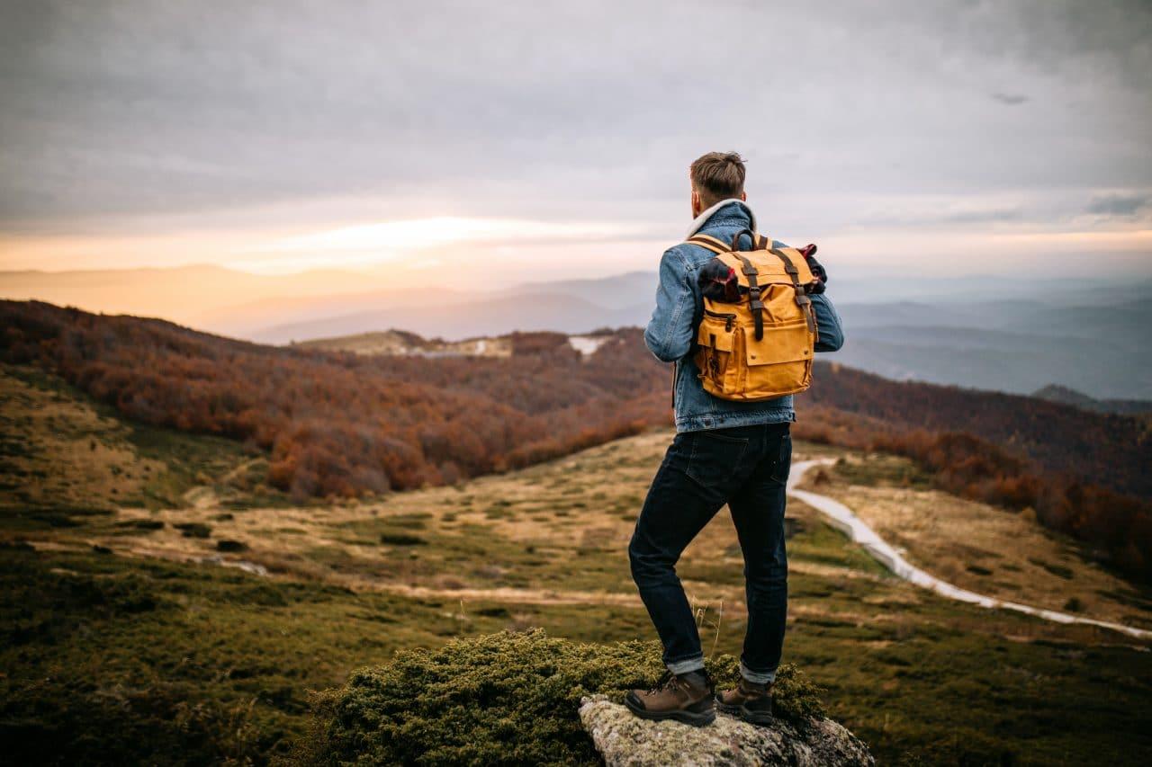 Man on a hike outside.