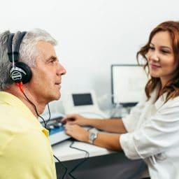 Senior man at medical examination or checkup in otolaryngologist's office